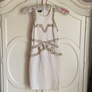 White gold and silver dress with peplum